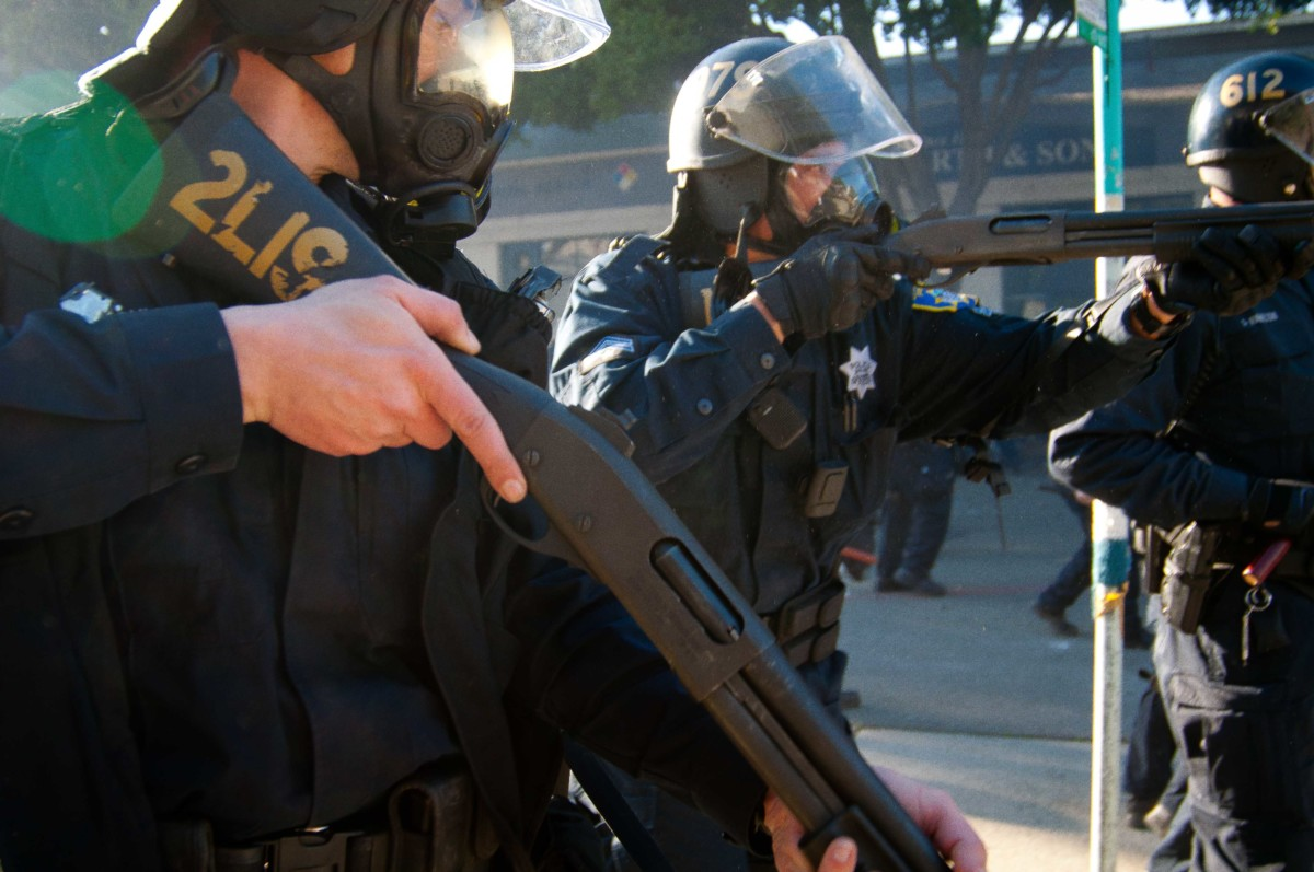 "Oakland Police Officers move in with ""non-lethal"" ammunition on Occupy protesters, January 28, 2012."