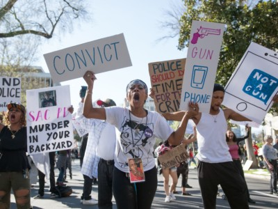 Black Lives Matter protesters march through the streets in response to the police shooting of Stephon Clark in Sacramento, California on March 28, 2018.
