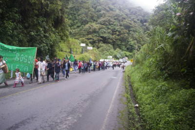Protesters march to demand an end to mining in Ecuador on March 22, 2018, near Mindo, Ecuador.