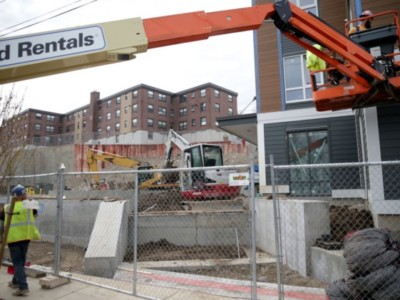 Construction takes place at the public housing complex in East Boston's Orient Heights on April 13, 2018.
