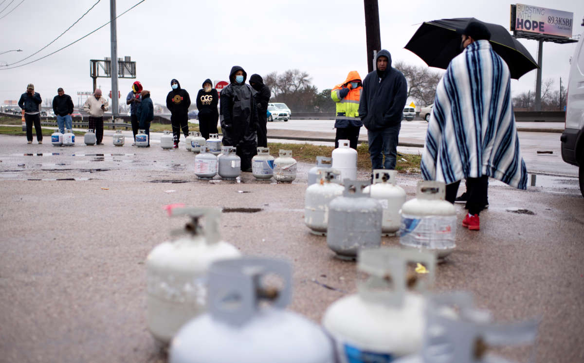 Propane tanks are placed in a line as people wait for the power to turn on to fill their tanks in Houston, Texas on February 17, 2021.