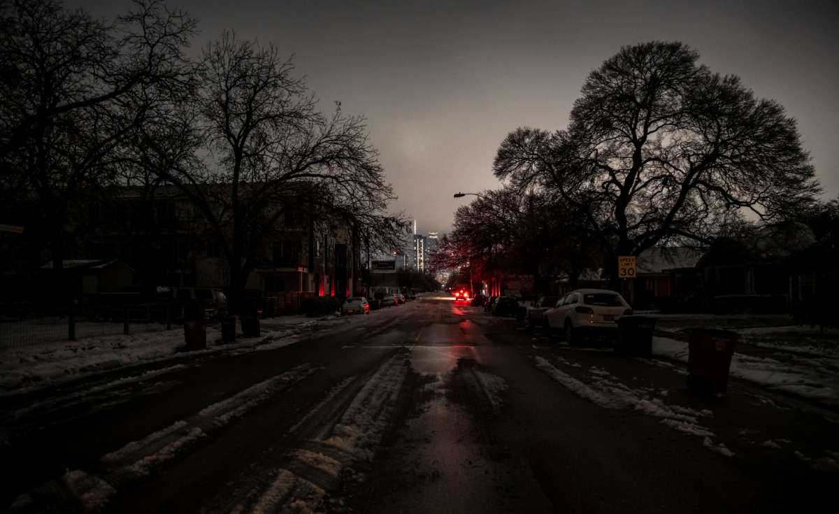 Buildings with power are lit in the distance from an area without power in Austin, Texas, on February 17, 2021.