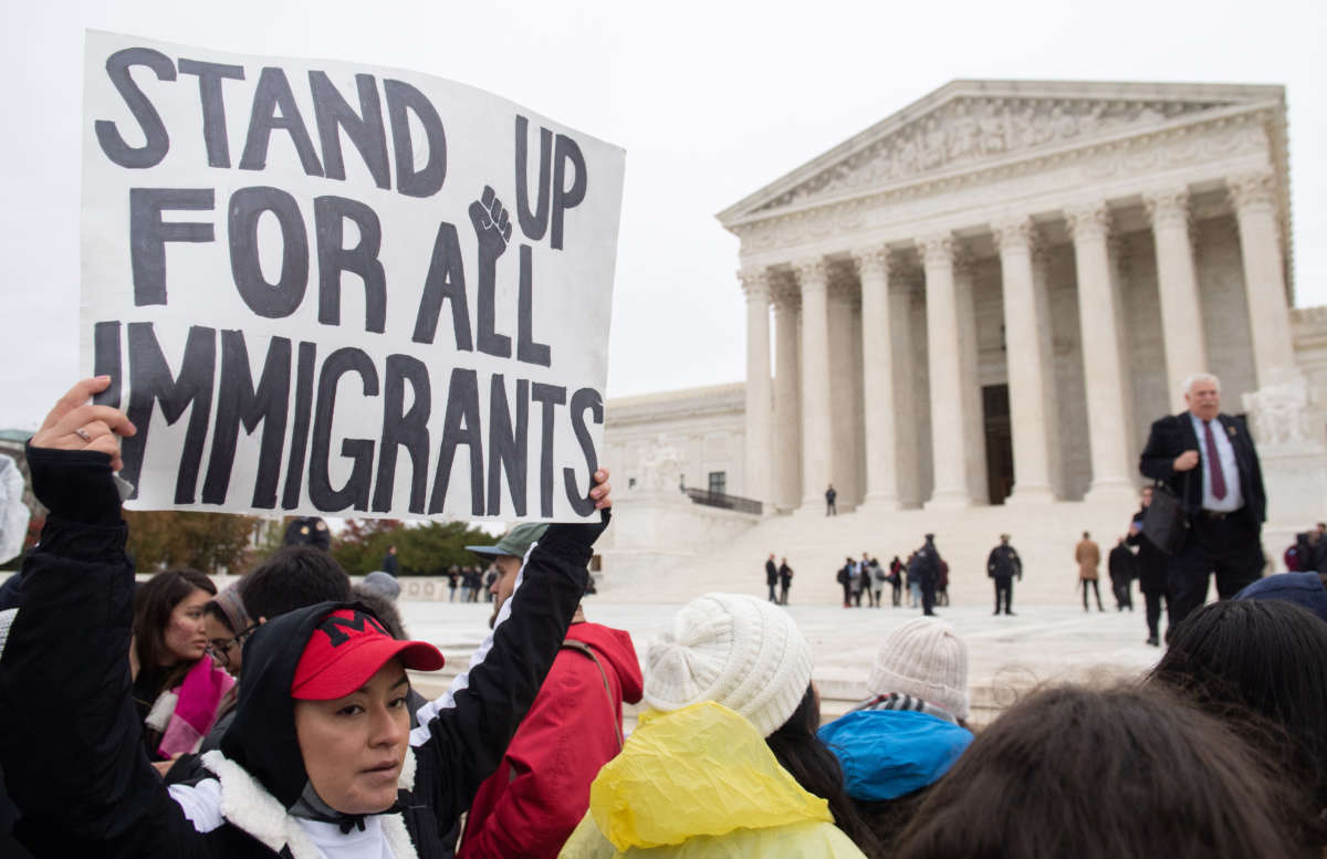 Immigration rights activists hold a rally in front of the Supreme Court in Washington, D.C., on November 12, 2019.