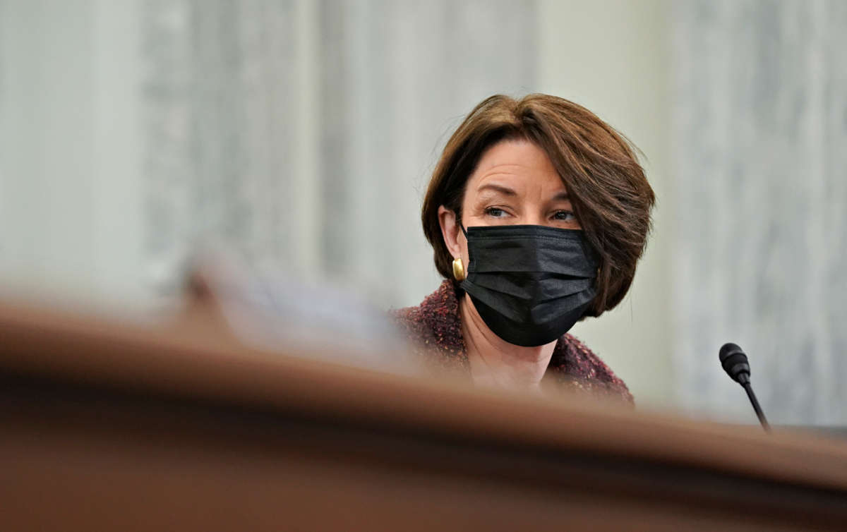Sen. Amy Klobuchar wears a protective mask during a Senate Commerce, Science and Transportation Committee confirmation hearing on January 21, 2021, in Washington, D.C.