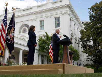 President Joe Biden delivers remarks on the COVID-19 response and vaccination program as Vice President Kamala Harris listens in the Rose Garden of the White House on May 13, 2021, in Washington, D.C.