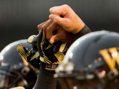 Wake Forest Demon Deacon players join hands prior to the game against the Liberty Flames at BB&T Field on September 1, 2012, in Winston Salem, North Carolina.