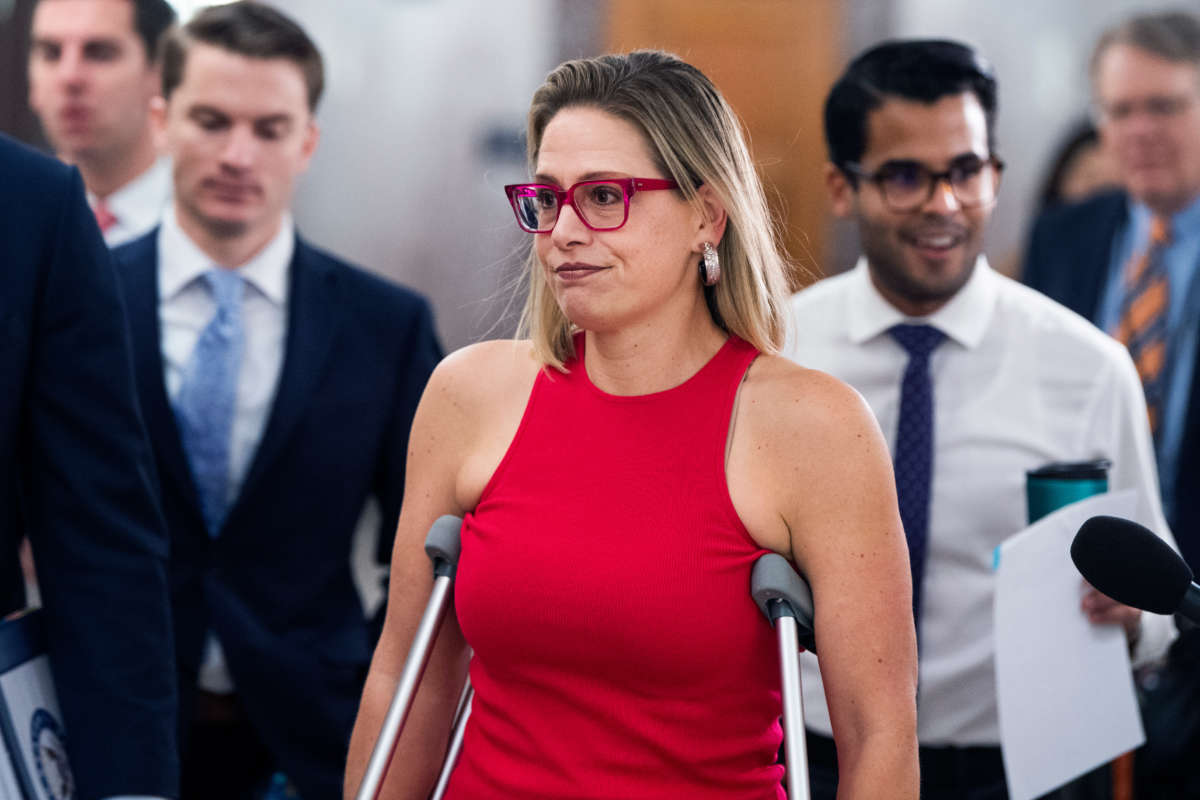 Sen. Kyrsten Sinema arrives for a Senate Homeland Security and Governmental Affairs Committee markup in Dirksen Building on June 16, 2021.