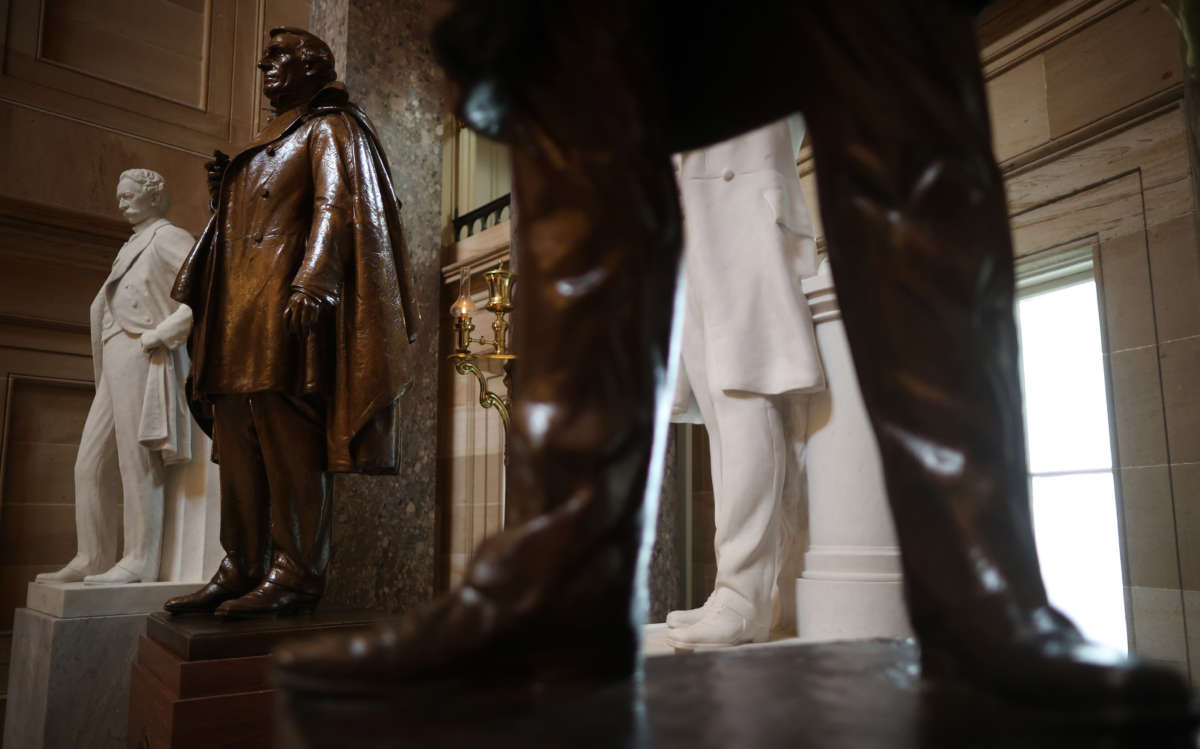 Statues of Jefferson Finis Davis, 2nd left, president of the Confederate States from 1861-1865, and Uriah M. Rose, left, an Arkansas county judge and supporter of the Confederacy, are on display in Statuary Hall inside the U.S. Capitol on June 18, 2020, in Washington, D.C.