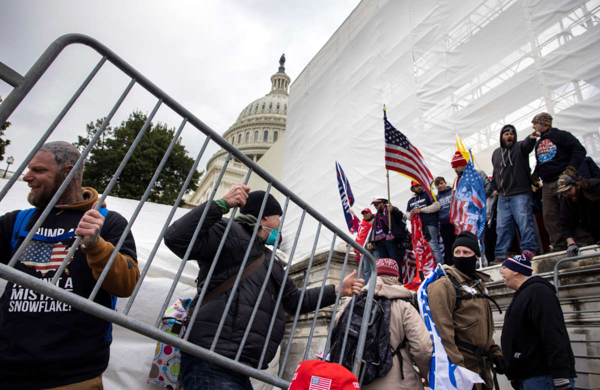 Trump supporters clash with police and security forces as people try to storm the U.S. Capitol in Washington, D.C., on January 6, 2021.