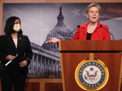 Sen. Elizabeth Warren holds a news conference with Rep. Pramila Jayapal to announce legislation at the U.S. Capitol on March 1, 2021, in Washington, D.C.