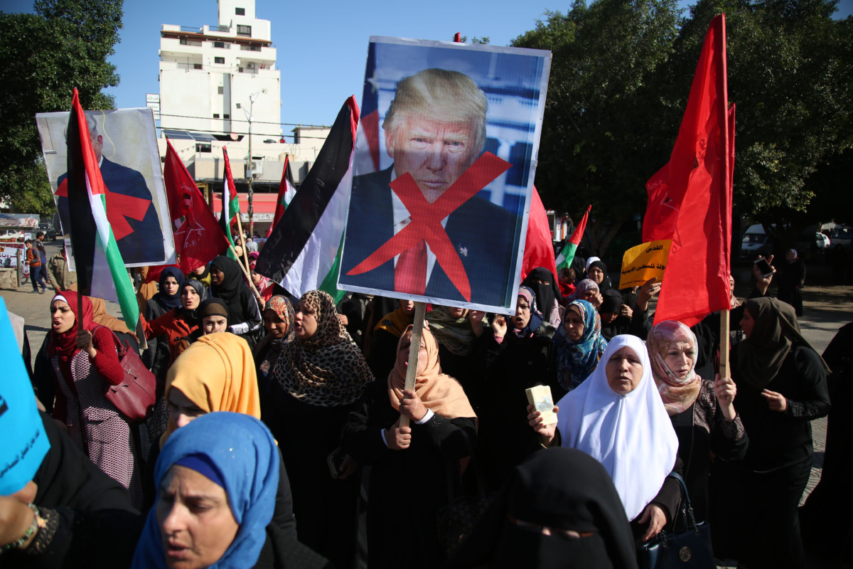 Palestinian women hold banners during a protest against US President Donald Trump's decision to recognize Jerusalem as the capital of Israel, in Gaza City on December 17, 2017.