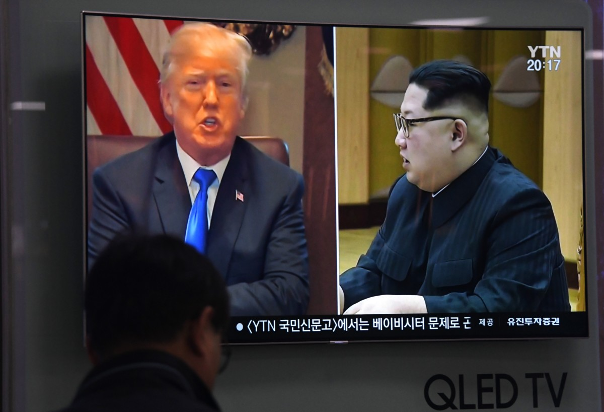 A man watches a television screen at a railway station in Seoul, South Korea, showing North Korean leader Kim Jong Un and Donald Trump, on May 24, 2018.