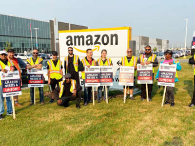 Members of Teamsters Locals 987 and 362 protest outside an Amazon fulfillment center in Alberta, Canada, on July 14, 2021, after meeting with Amazon workers across the country to discuss working conditions and union organizing.