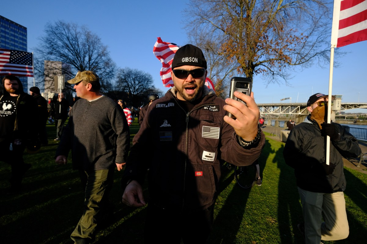 Joey Gibson, leader of the Patriot Prayer group, leads his supporters along the waterfront in Portland, Oregon, on December 9, 2017.