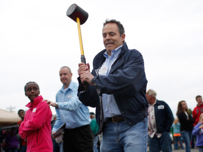 Gov. Matt Bevin swings a mallet on the 'High Striker' game at the Fountain Run BBQ Festival while campaigning for the Republican primary May 17, 2014, in Fountain Run, Kentucky.