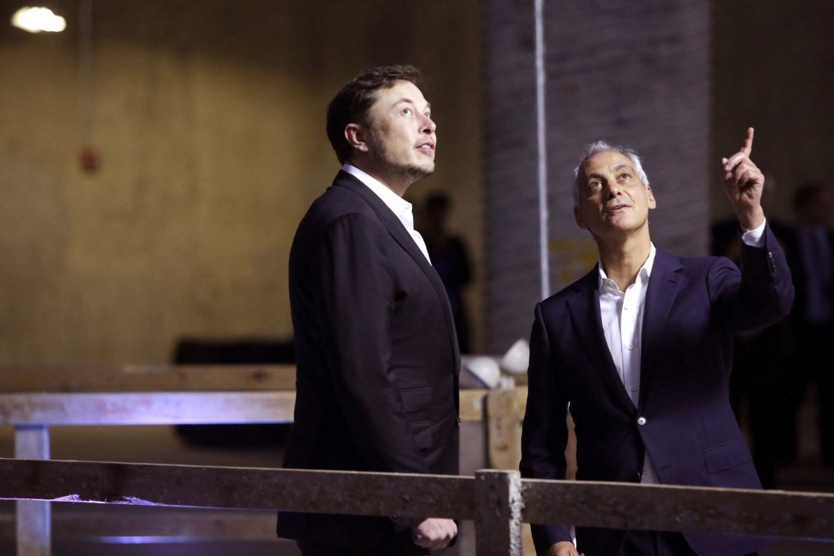 Chicago Mayor Rahm Emanuel talks with Elon Musk at Block 37 on June 14, 2018, in Chicago, Illinois.