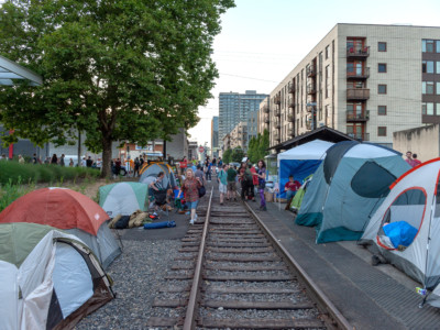 Tents are planted on either side of the old trolley rail at OccupyICEPDX, just in front of the ICE Portland headquarters in southwest Macadam on June 19, 2018, in Portland, Oregon.