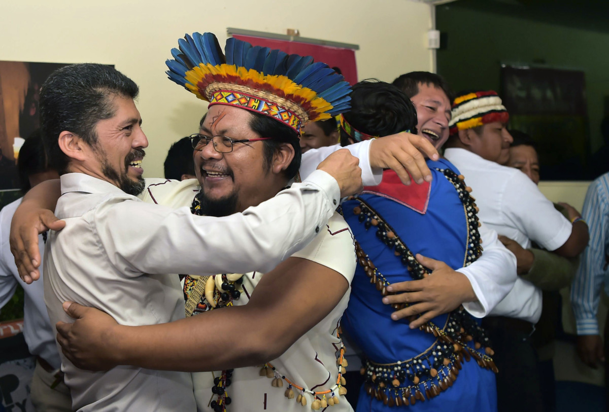 Pablo Fajardo, lawyer for the victims of environmental damage caused during Texaco's oil operations in the Ecuadoran Amazon (1964 to 1990), acquired by Chevron in 2001, celebrates with his clients, during a press conference in Quito, on July 11, 2018.