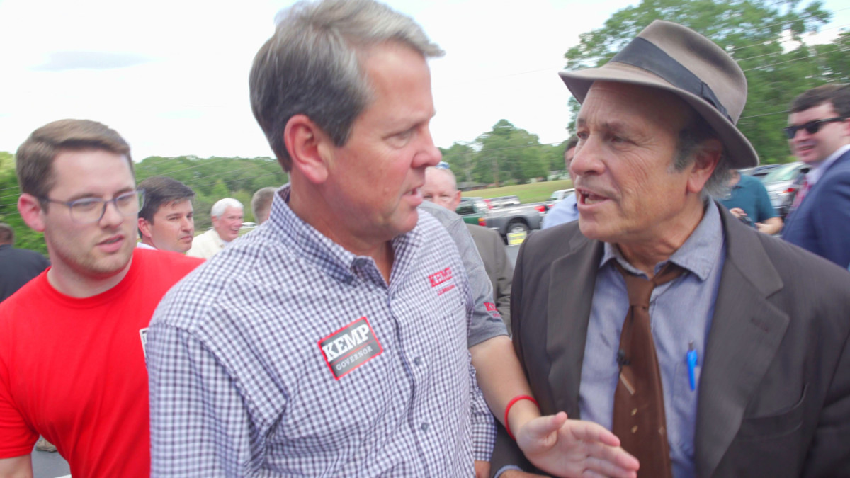 "Journalist Greg Palast confronts GOP candidate for Governor of Georgia Brian Kemp outside the Sprayberry Barbecue in Newman, Georgia, asking, ""Mr. Kemp are you removing Black voters from the voter rolls just so you can win this election?"""