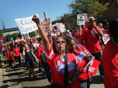 Striking Chicago public school teachers and their supporters march through the streets following a rally at Union Park September 15, 2012, in Chicago, Illinois.