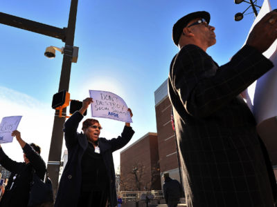 Norma Sanabria, left to right, Monica Ross, and Wesley Hayes protest cuts to Social Security outside the US Social Security Administration building along North Greene St. on Wednesday, December 5, 2012 in Baltimore, Maryland.