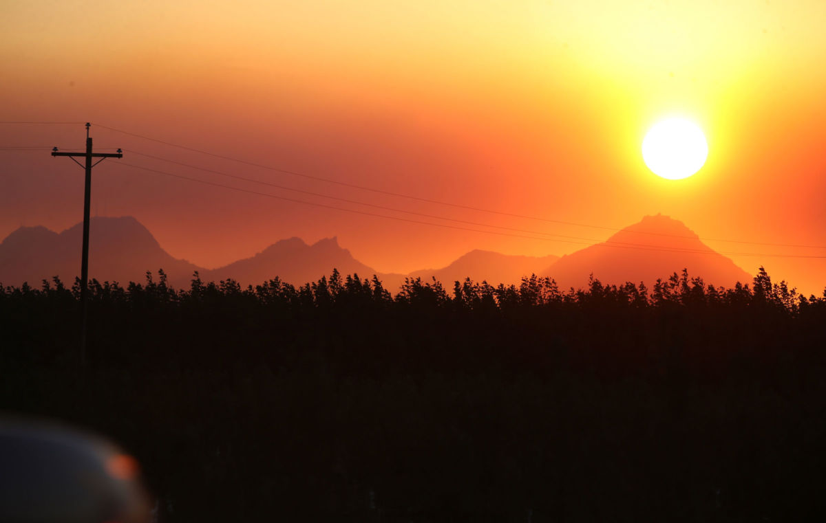 The sun sets behind clouds of smoke from the Camp Fire seen from Highway 70 in Marysville, California, on November 8, 2018.