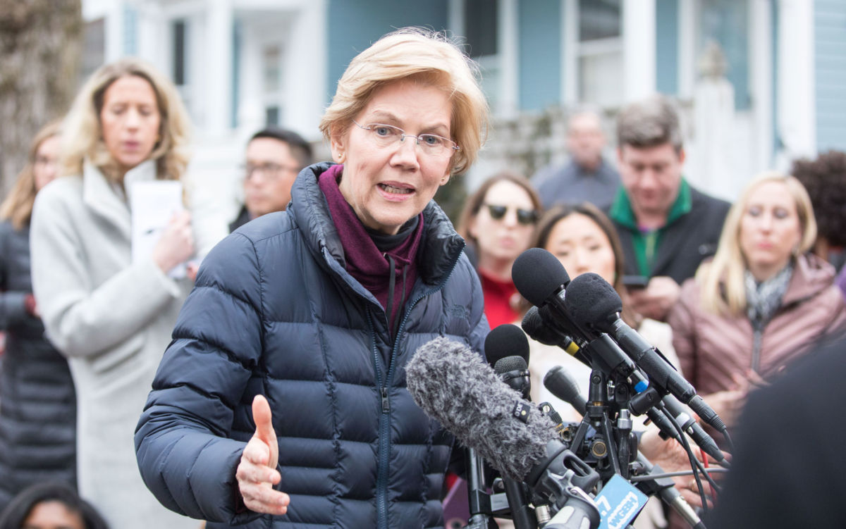 Sen. Elizabeth Warren addresses the media outside of her home after announcing she formed an exploratory committee for a 2020 presidential run on December 31, 2018 in Cambridge, Massachusetts.