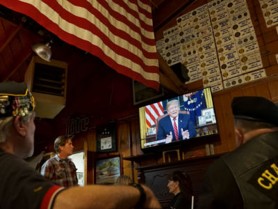 Members of American Legion Post 416 watch President Trump speak on January 8, 2019, in Encinitas, California.