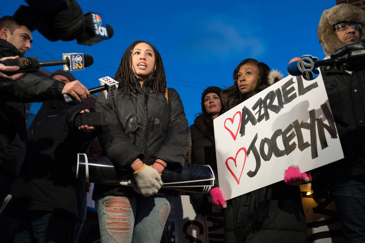 """Demonstrators gather near R&B singer R. Kelly's former recording studio in Chicago on January 9, 2019, following the release of a Lifetime docuseries """"Surviving R. Kelly,"""" which highlighted years of sexual abuse against young Black women."""
