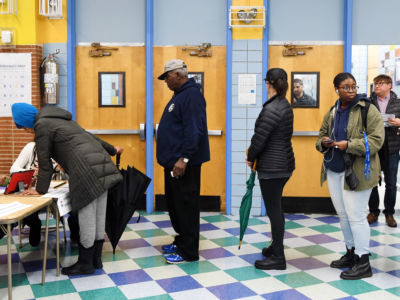 Voters register at a polling station in Manhattan of New York, the United States, on November 6, 2018.