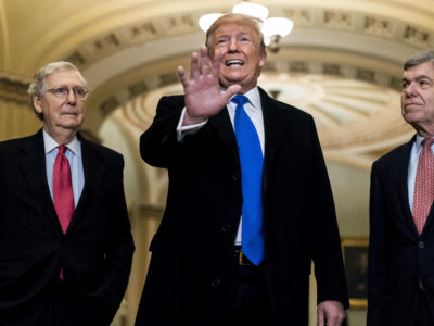 Donald Trump stands between Sens. Mitch Mcconnell and Roy Blunt