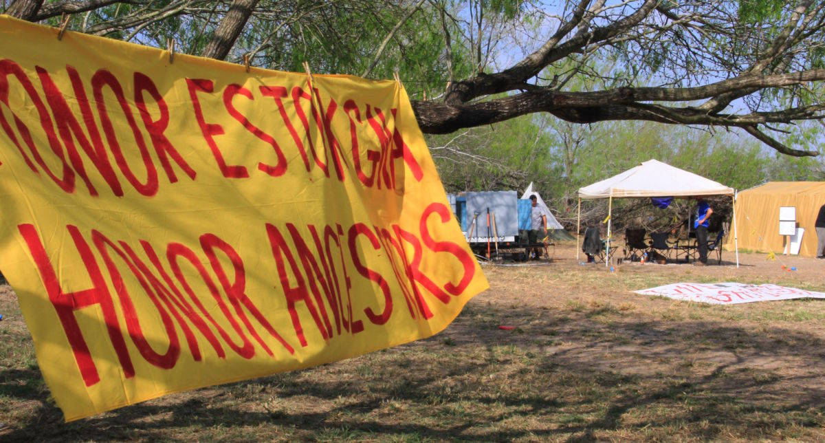 A banner at the Yalui camp at the Eli Jackson Cemetery in San Juan, Texas, on March 1, 2019.