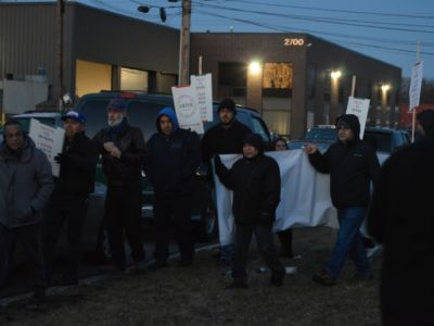 Headly Manufacturing workers picketing during a strike outside of Chicago.