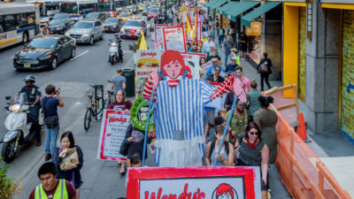 Protesters with Wendy prop in front of Wendy's owner Nelson Peltz's offices