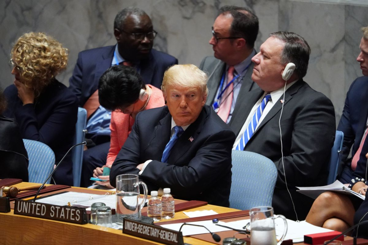 Donald trump sits with his arms crossed at the United Nations