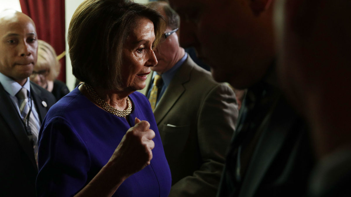 Nancy Pelosi speaks to members of the media after a House Democrats meeting at the Capitol