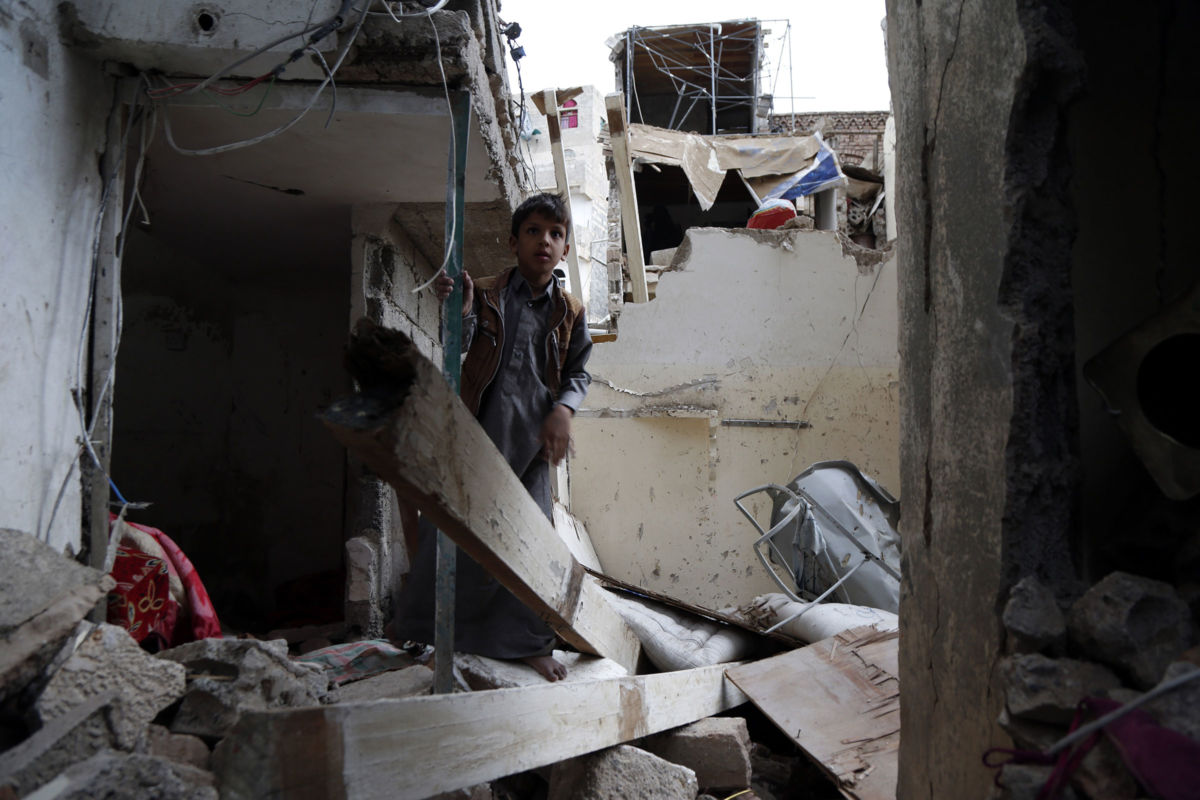 A child stands on rubble of houses a day after they were hit by airstrikes carried out by the Saudi-led coalition that left six people killed and more than 40 others injured on May 17, 2019, in Sana'a, Yemen.