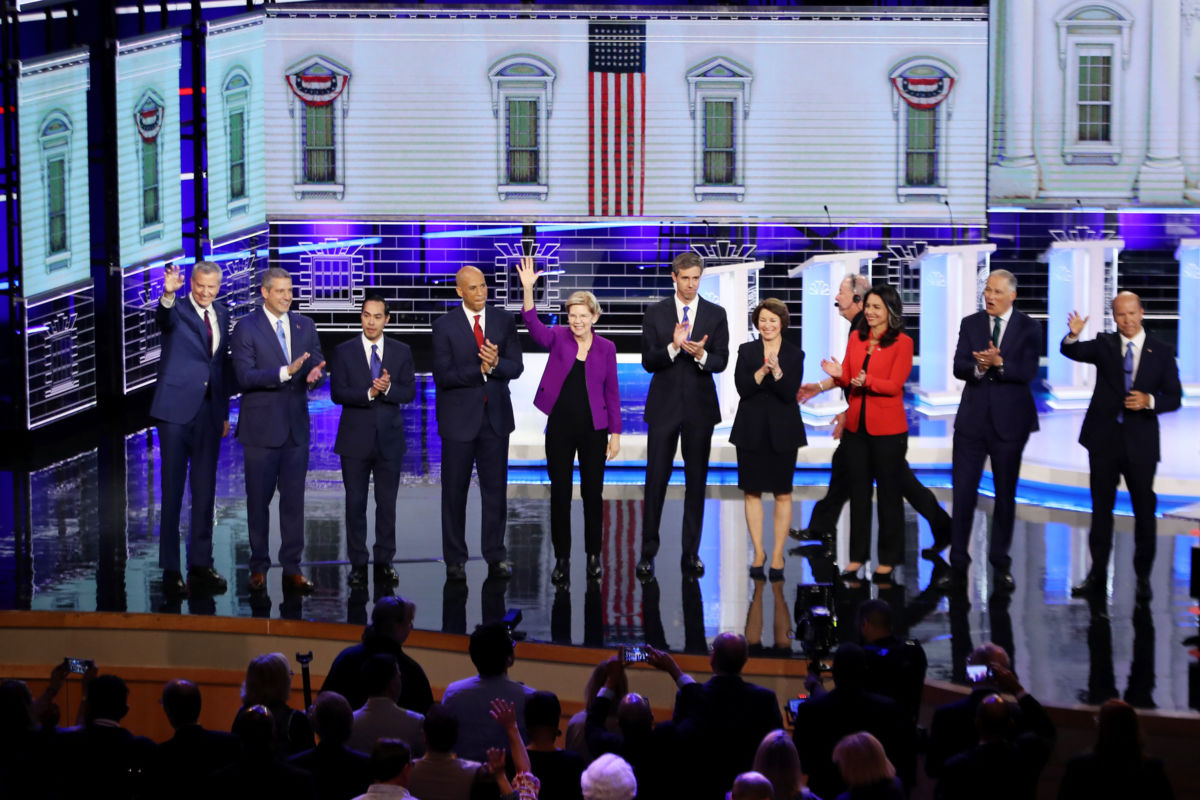 Democratic presidential candidates take the stage during the first night of the Democratic presidential debate on June 26, 2019, in Miami, Florida.