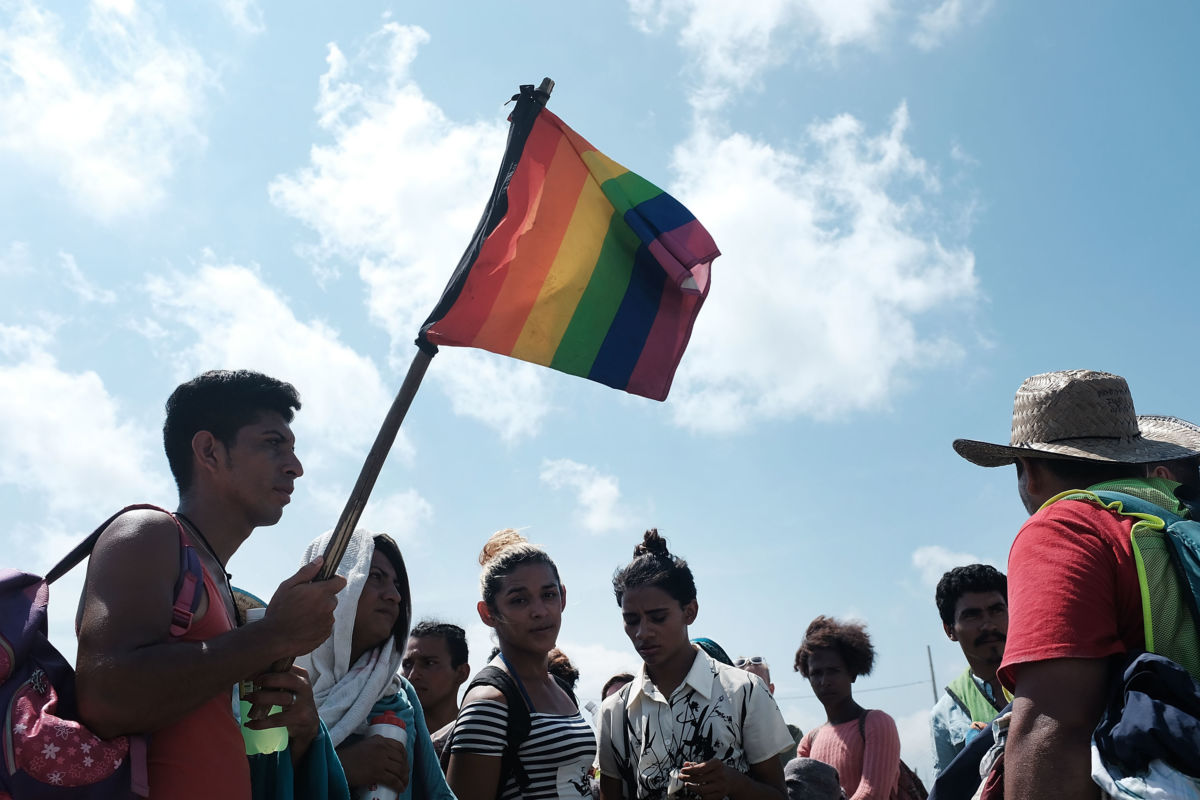 Members of an LGBT group traveling with the the Central American migrant caravan wait for a ride on November 1, 2018, in Juchitan de Zaragoza, Mexico.