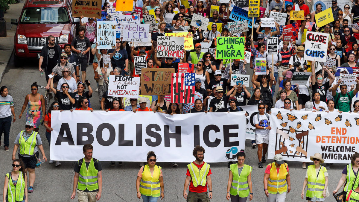 Protesters march to offices of the U.S. Immigration and Customs Enforcement on July 13, 2019, in Chicago, Illinois.