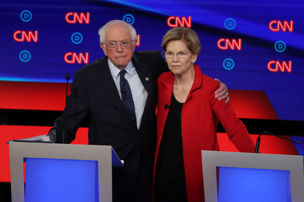 Bernie Sanders and Elizabeth Warren embrace