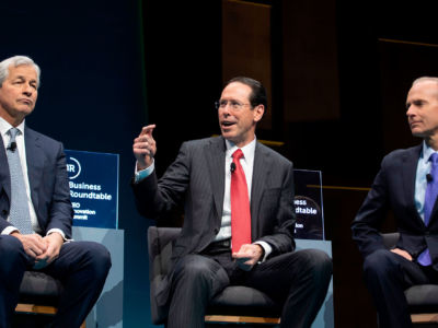 JPMorgan Chase & Co. CEO Jamie Dimon (L), AT&T CEO Randall Stephenson (C) and Boeing CEO Dennis Muilenberg (R) speak during the Business Roundtable (BRT) CEO Innovation Summit