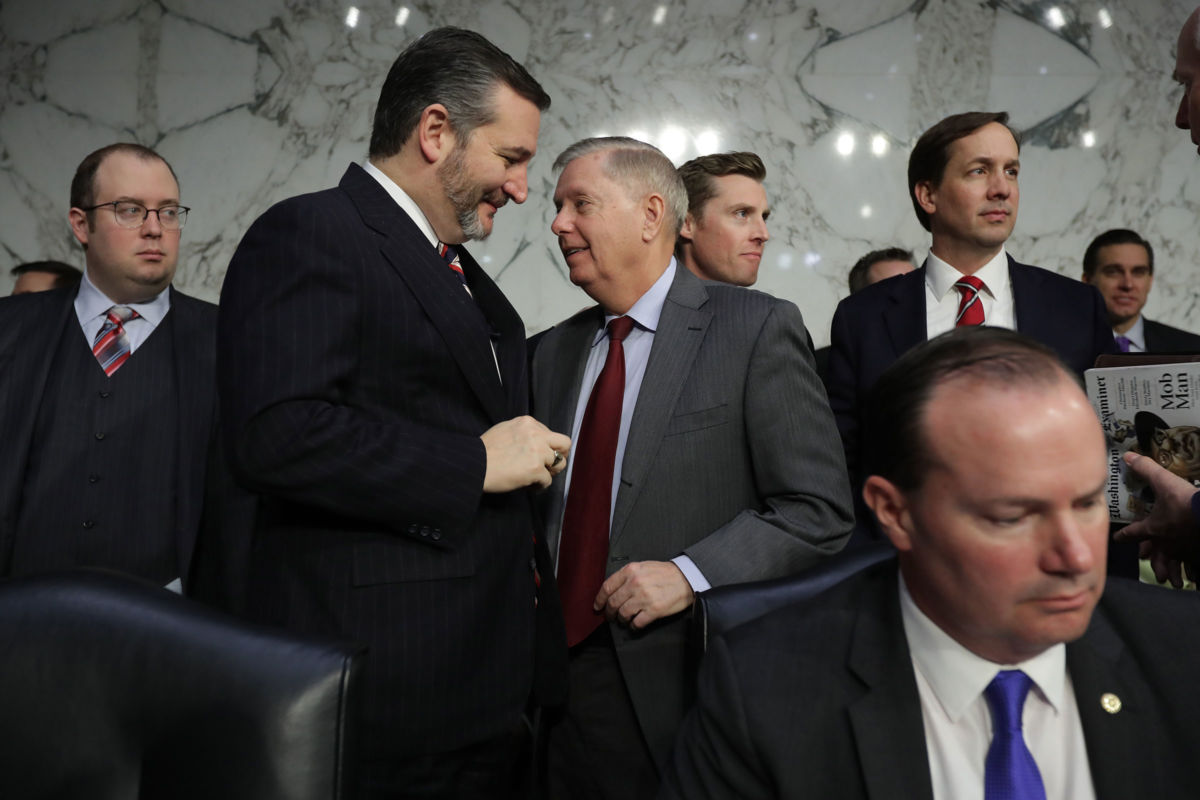 A group of 21 Republicans led by Sen. Ted Cruz (2nd L) wrote a letter pushing for a move that would save wealthy investors billions of dollars a year.