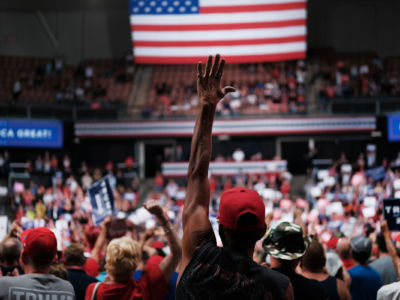 People react as President Trump speaks to supporters at a rally on August 15, 2019, in Manchester, New Hampshire.