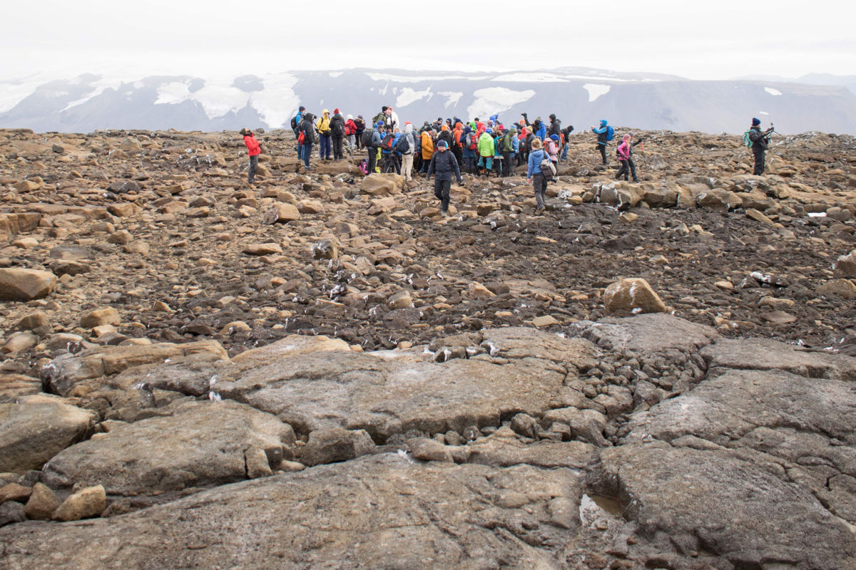 People attend a monument unveiling at the site of Okjökull, Iceland's first glacier lost to climate change, in the west of Iceland on August 18, 2019.