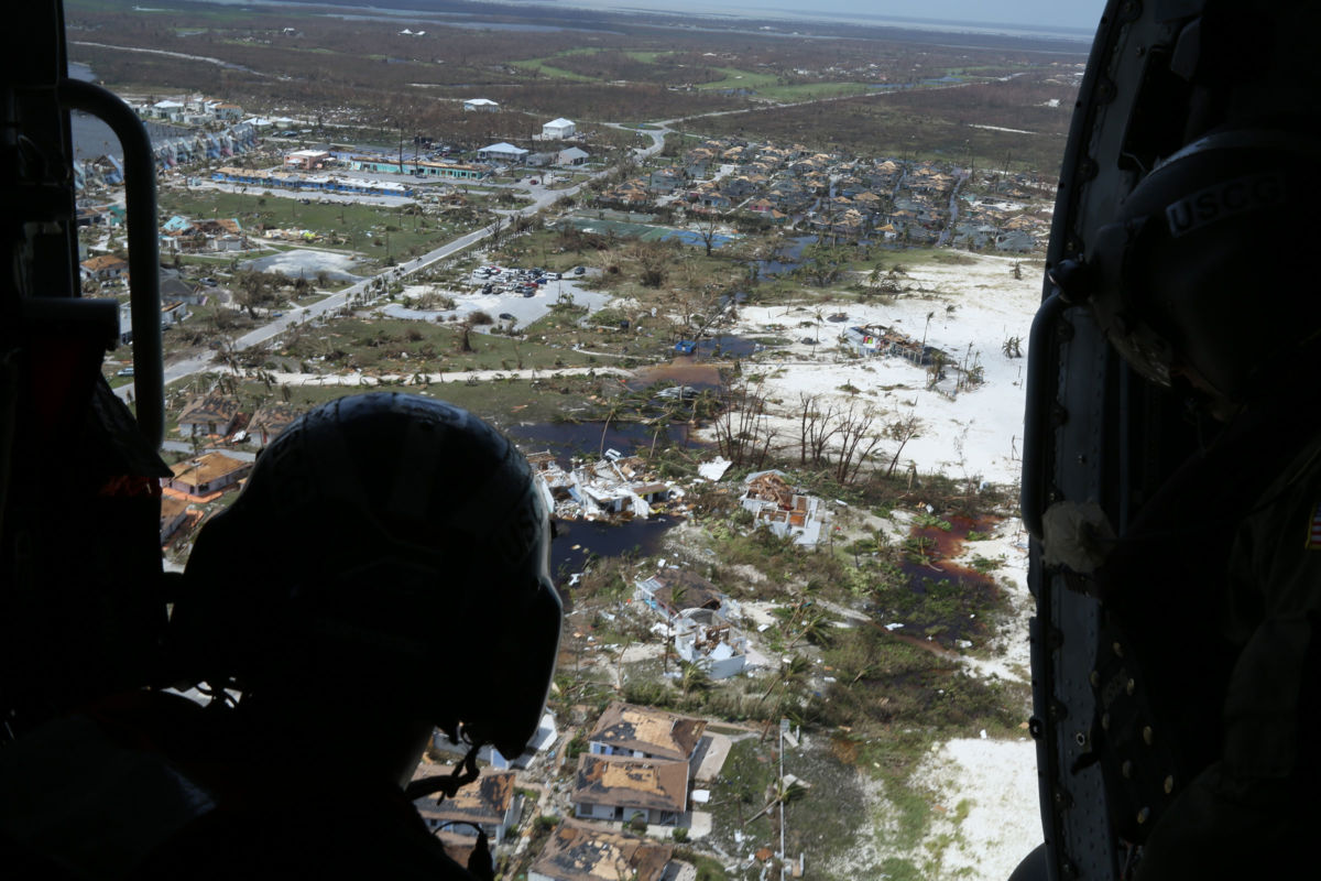 Mike Lewis of the U.S. Coast Guard inspects areas damaged by Hurricane Dorian in support of search-and-rescue efforts and humanitarian aid in the Bahamas on September 4, 2019.