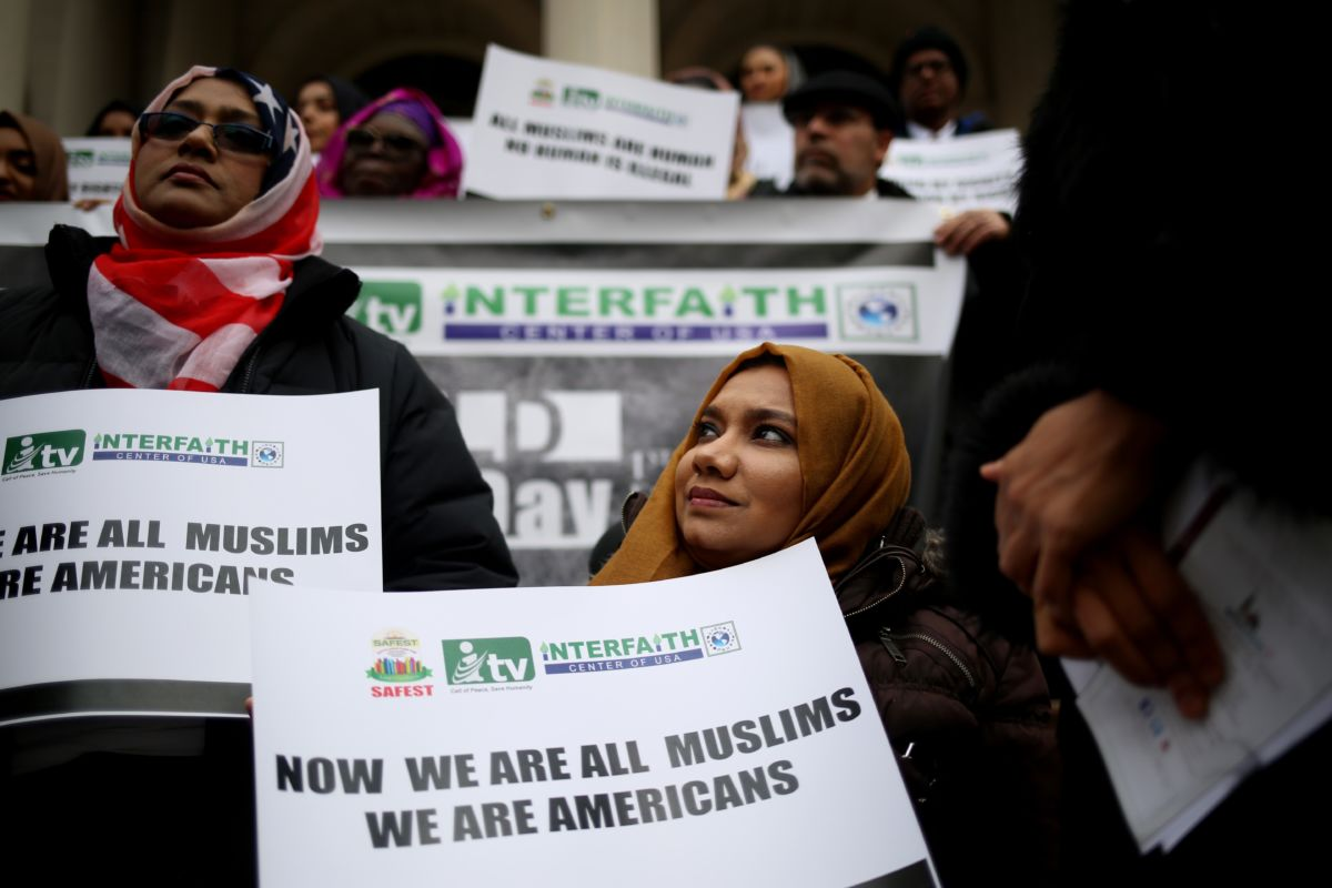 Hijabis display signs during a protest