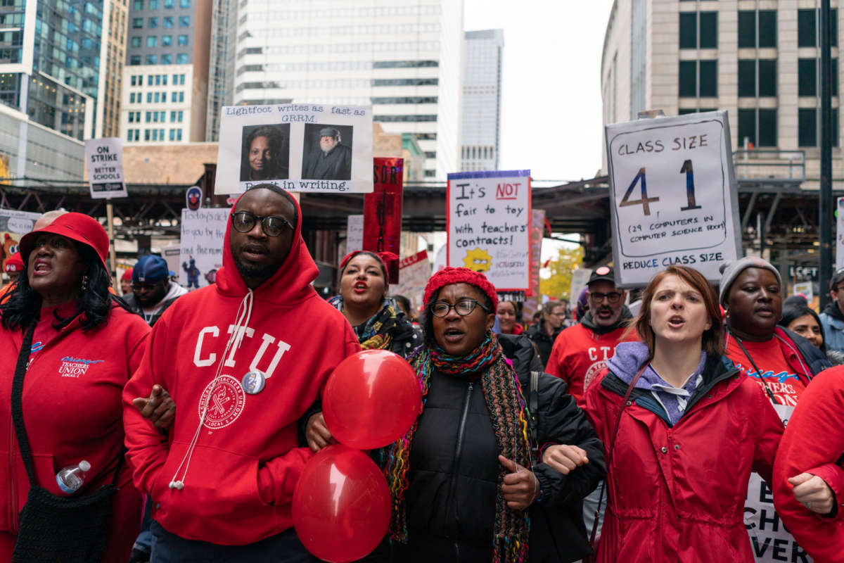 Striking teachers, school staff and supporters march through downtown Chicago on the ninth day of the Chicago Teachers Union strike on October 25, 2019.