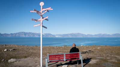 Signs show the distances to various cities in the town of Pond Inlet, in the Canadian Arctic, where a small Inuit settlement with only 1,300 inhabitants will deal with the consequences of climate change. Global warming here is two to three times stronger than in other regions of the world.