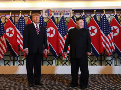 President Trump and North Korea's leader Kim Jong Un arrive for a meeting at the Sofitel Legend Metropole hotel in Hanoi on February 27, 2019.